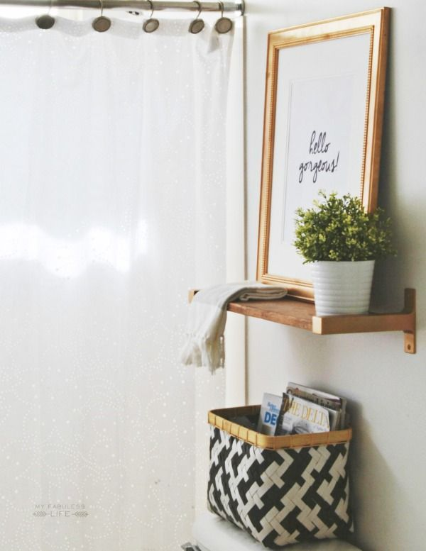 Small bathroom organization tip: utilize the space above your toilet: small shelf or simply a weave basket. | Small space Big Style: metal photo frame, sharp black and white basket.