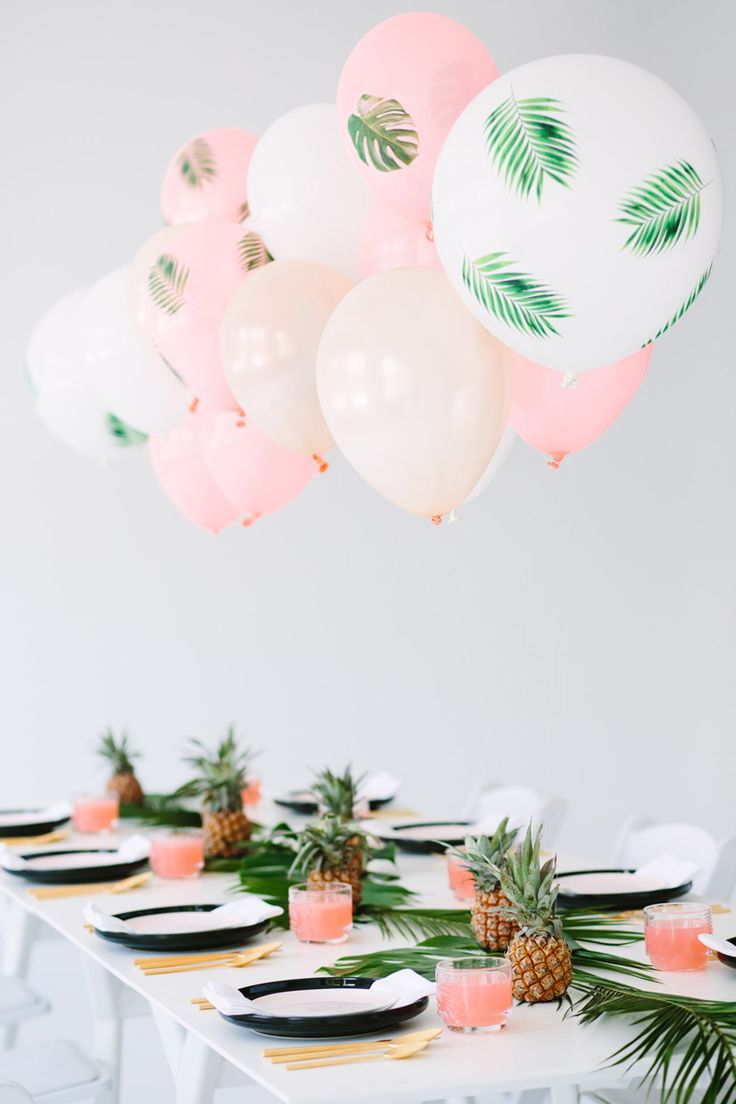 Make the balloons the star of the party. Print palm fronds onto tissue paper, cut them out and spray glue them to inflated balloons for a look your guests are sure to gush over. Click through for tools and a tutorial!