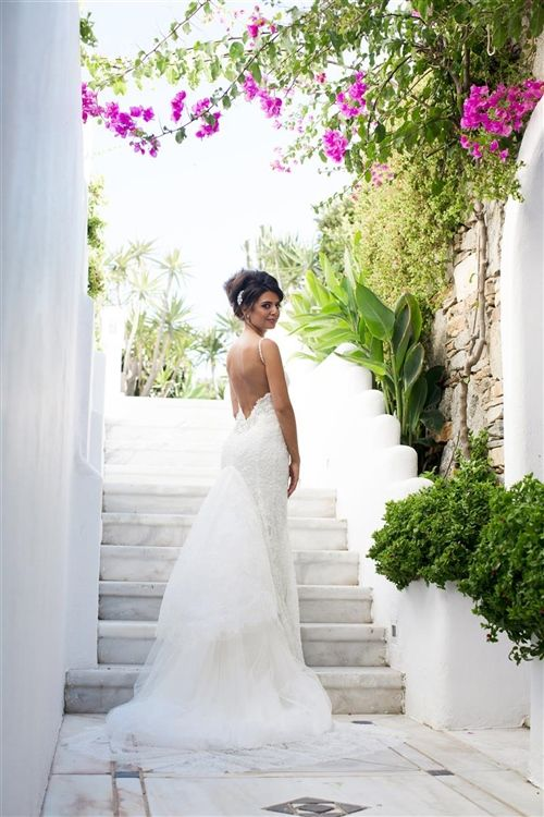 Our beautiful, London based couple, Andrea and Stephen opted for a stylish and romanticMykonos wedding overlooking the Aegean sea to honour the brides Greek origin. Soft white,dusty grey and golden wedding colour palette,elegant and feminine tablescapes with naturalstyle florals were perfectly complimented by the ambient lightingand five star hotel pool venuefor an unforgettable celebration among dear friends and family.