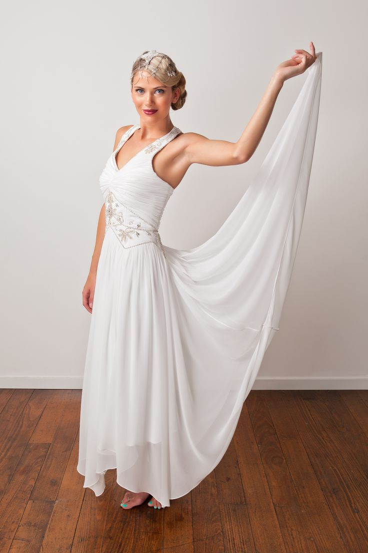 'Kirsten' gown. Boho brides, this beaded halter neck dress is free spirited and laid back. With a swishy handkerchief hem <3
