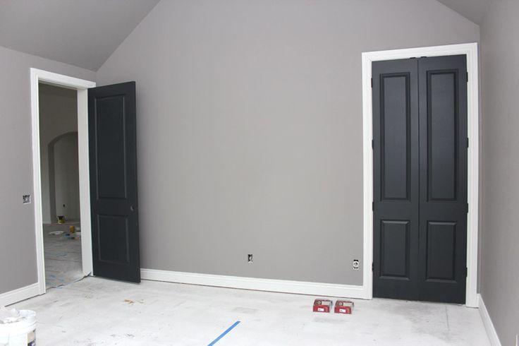 Gray walls, white trim, black doors
