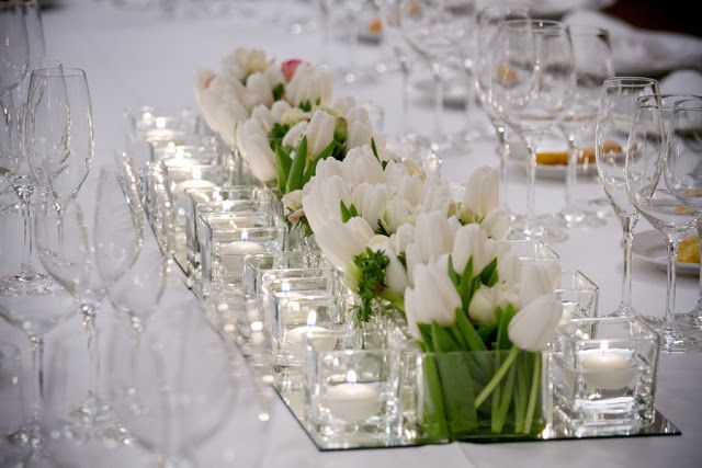 Cocktail Table Concept for Lounge Vignette- Petite Square Vases with White Tulips flanked with 2 lines of square votive candles.