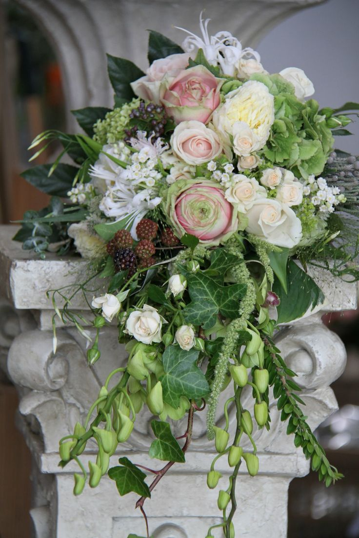 Love the draping leaves berries roses wedding bouquet for Flower sprays for weddings