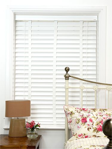 White wooden wide slat venetian blinds. 64mm slats. Look of plantation shutters without the price.