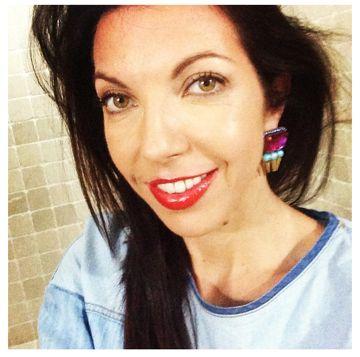 Kaitie Manani wearing her Innika earrings in sunny singapore