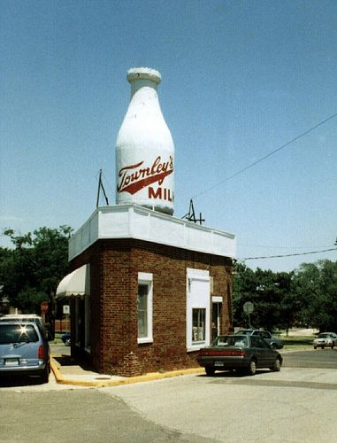 Townley's Milk, Route 66 Oklahoma City...Old Townley's Milk Bottle Building in Oklahoma City on one of the early Route 66 alignments. This bottle is now painted as a Braum's advertisement. The building now houses an Asian food carryout nail shop.