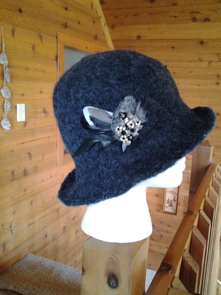 Longer rolled brimmed wool felted hat. Love the vintage broach with black and crystal added for bling!