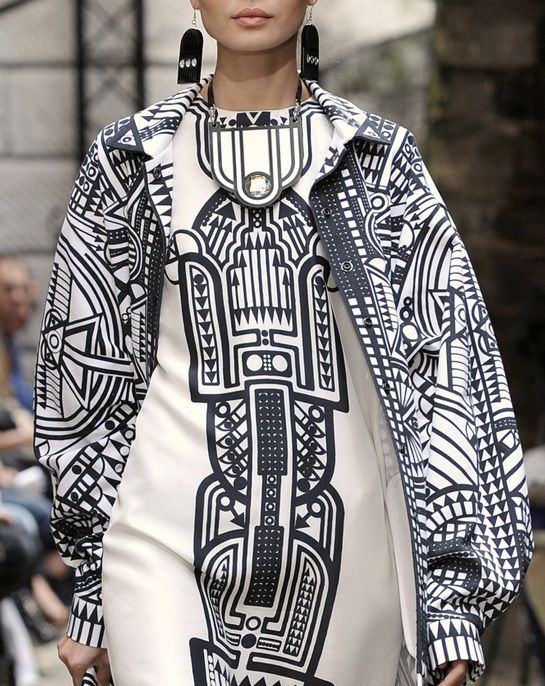 A digital print designed by Holly Fulton. I have chosen this because even though she has only used monochrome colours she has created an intriguing design which accentuates the shape of the model.