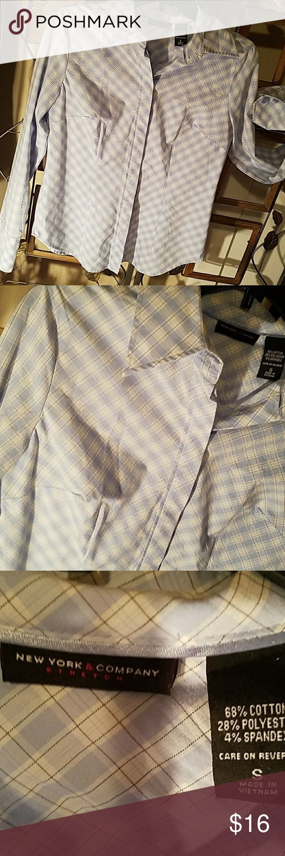 NY & COMPANY tailor made shirt size Small The perfect tailor made shirt for business or fun. Light blue and white are the dominant colors.  Buttons down front are hidden just an overall well made, classic wardrobe must have.  In great condition seemingly like new. Gently worn history. New York & Company Tops Button Down Shirts