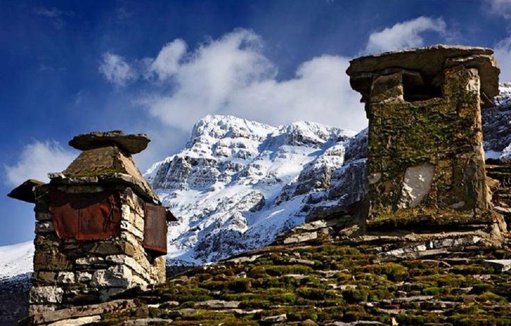 GREECE CHANNEL  Papigo village and Astraka (also known as Gamila and Tymfi) mountain. Zagori, Ioannina, Epirus, Greece.