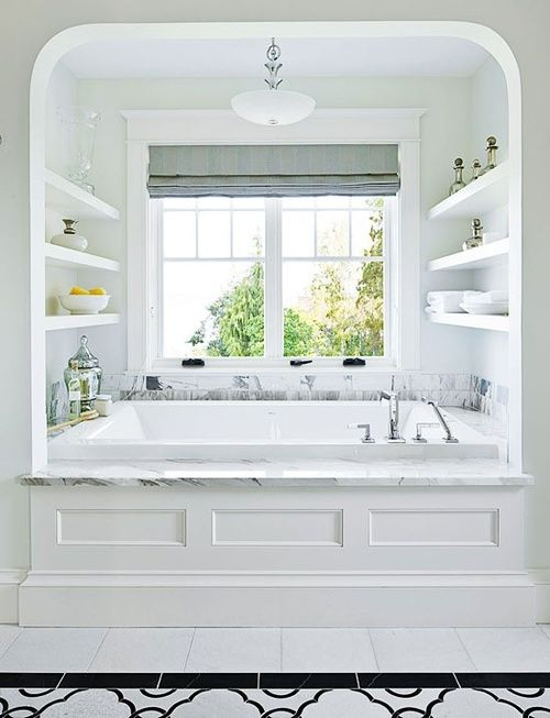 I like the big window behind the tub, the shelfs, and that it's kind if in it's own little bay window. Don't like much else about this bathroom though, except maybe that it's very white.