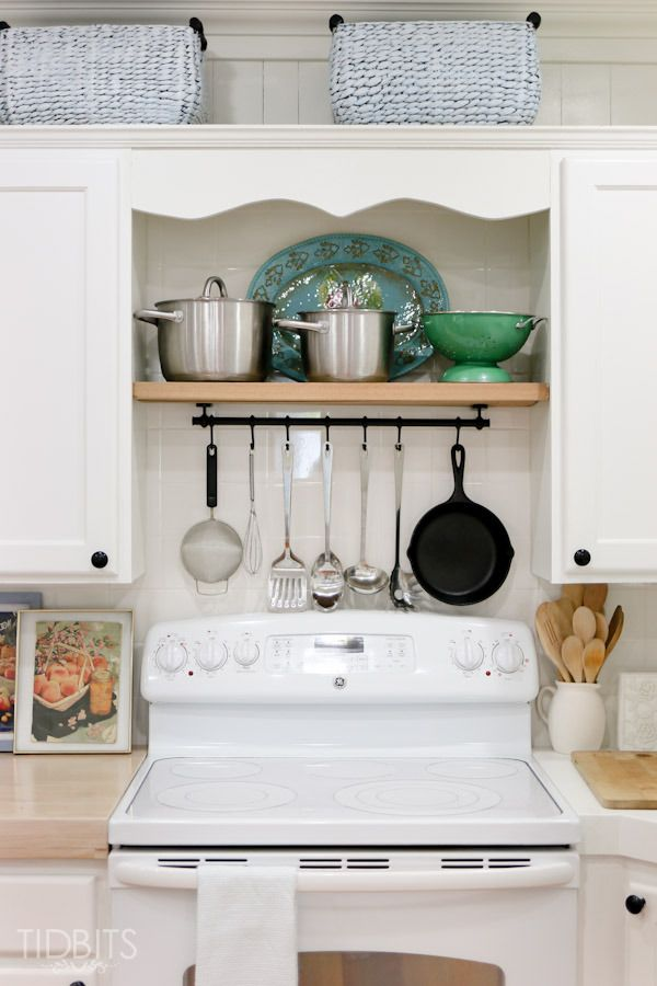 The Finished Cottage Fresh Kitchen - Tidbits - Love the shelf and hanging rack above the stove.