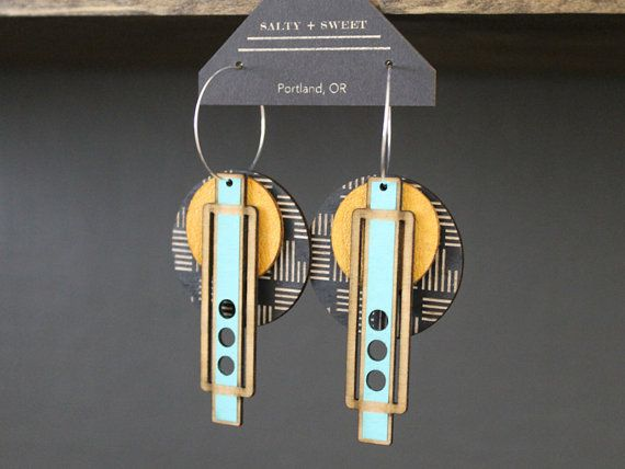 Lightweight leather + birch statement earrings, designed and laser cut in-house in Portland, OR.  The leather and birch materials are light as a feather, allowing you to have the look of a statement earring without the weight. Each layer is separate, meaning you remove, re-order, and