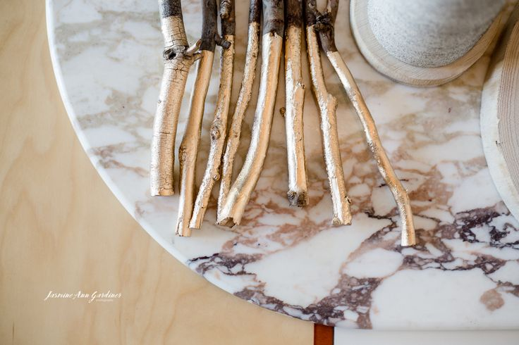 DY.o events (aka Duo)  Gold dipped twigs on marble for minimal and modern Christmas table piece