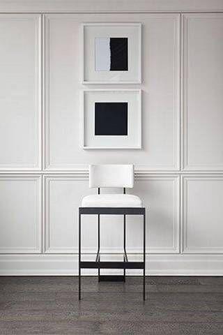 A simple black & white entryway, white paneled walls