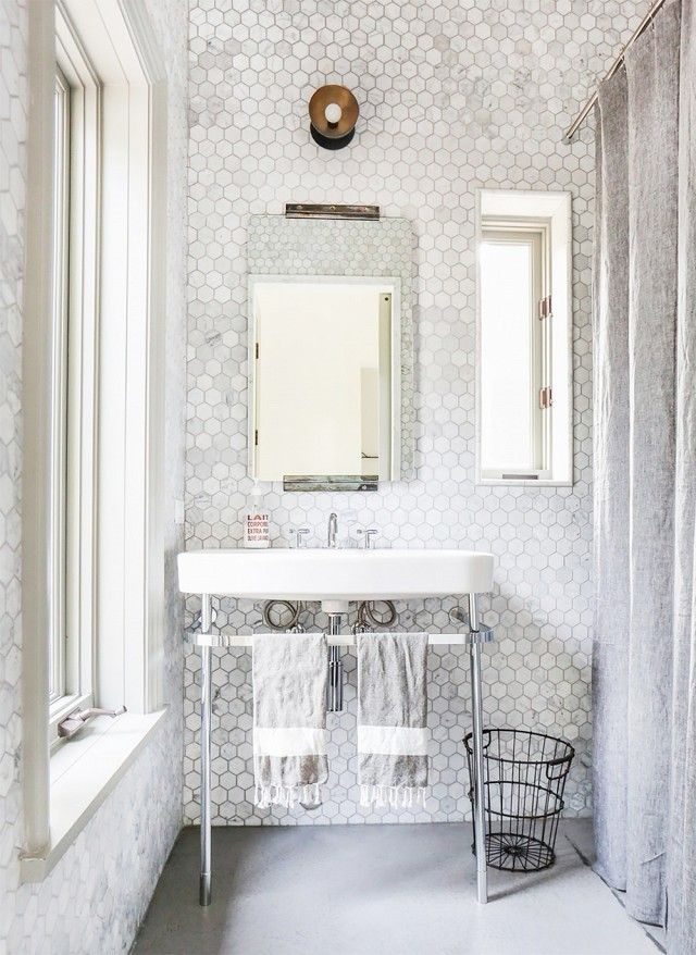 What a cute guest bathroom. I love the hexagonal tile work and wire basket.