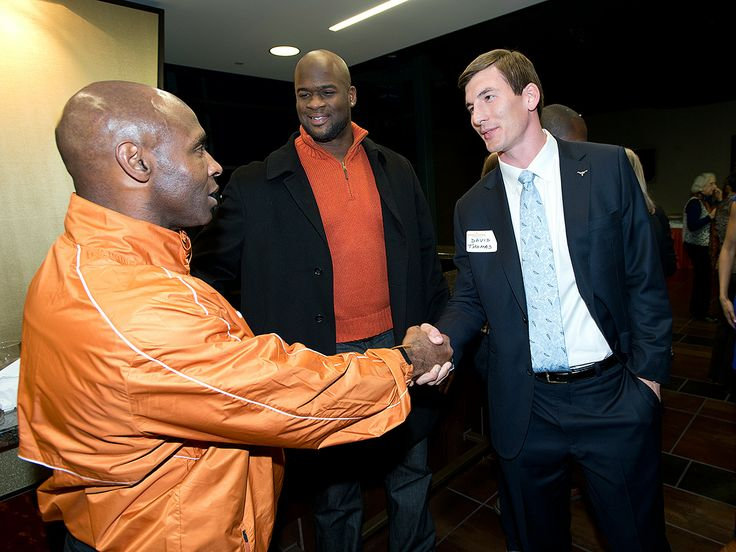 Charlie Strong meets former Texas Football TE David Thomas while former Texas QB Vince Young looks on at a reception Monday, Jan. 6, 2014.