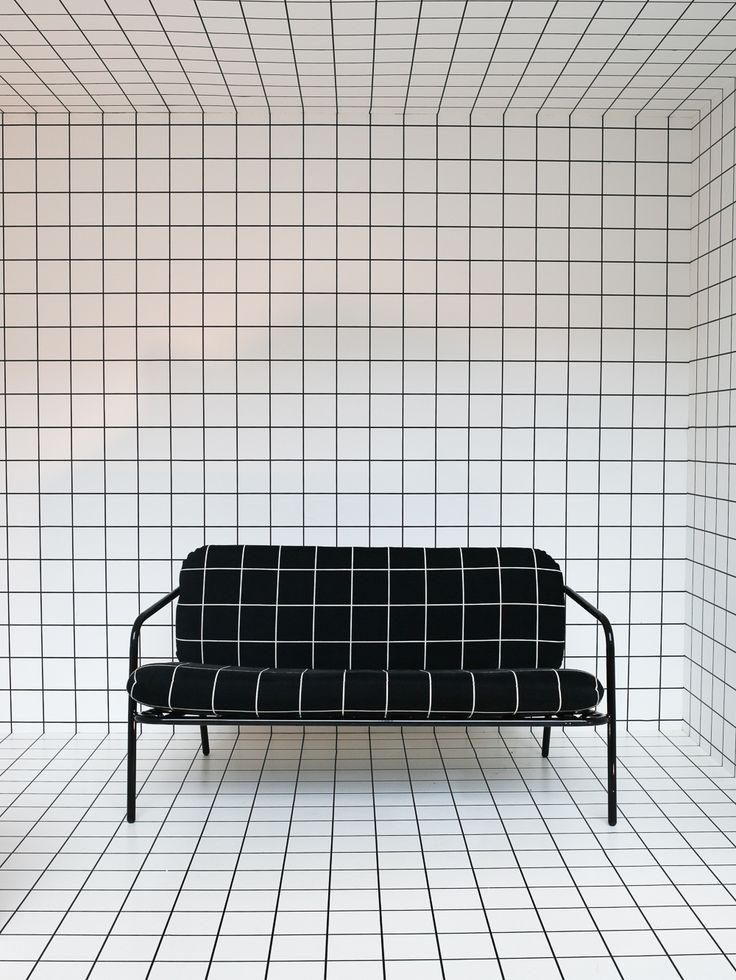 Monochrome grid patterns at designjunction. Deadgood sofa upholstered in black and white 'Window' design by Kirkby Design.