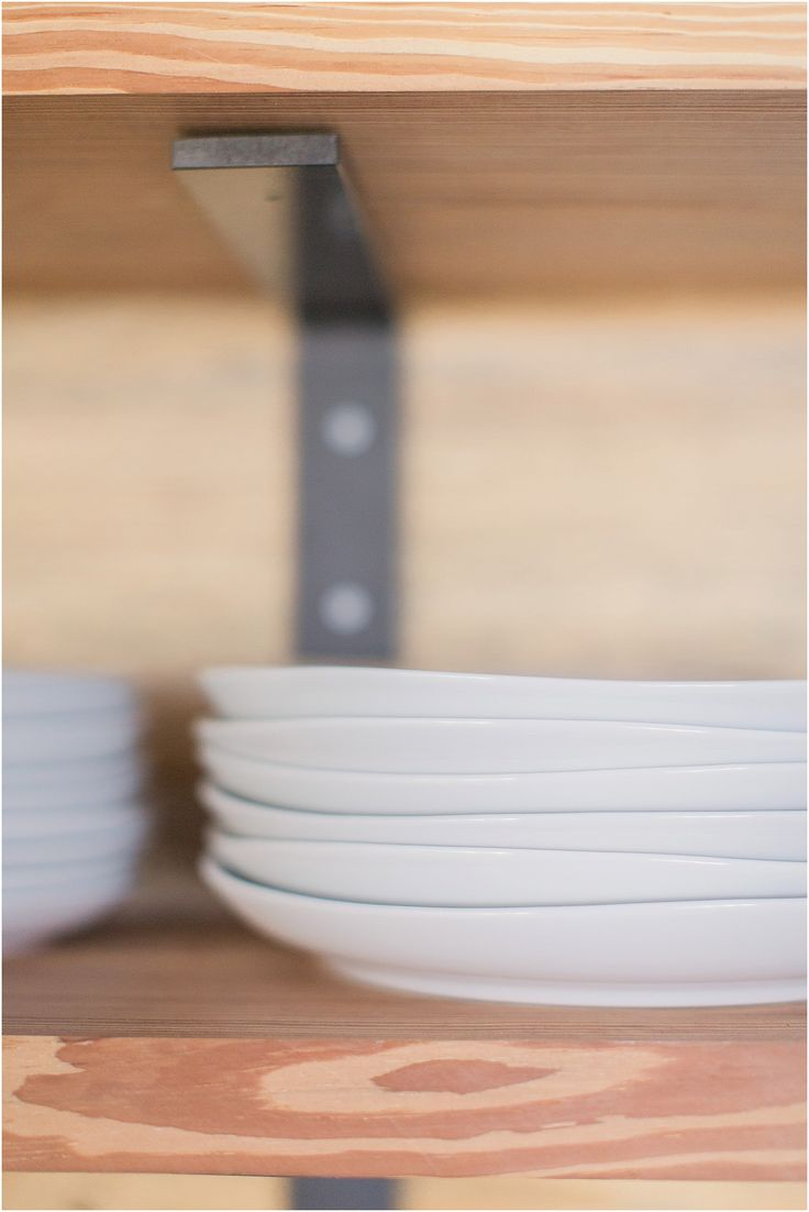 Open Shelves made from late 19th Century trusses and West Elm Organic Dinnerware