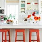 10 Country Kitchen Decorating Ideas | Midwest Living: Bright Kitchens, Kitchens Design, Open Shelves, Orange Stools, Pop Of Colors, Bar Stools, Bright Colors, Kitchens Stools, White Kitchens