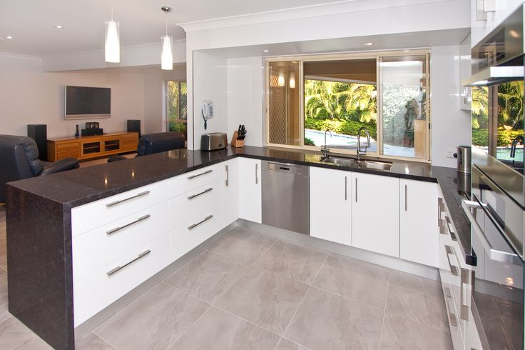 A servery window brings your kitchen into the outdoor entertaining area. www.onecallkitchens.com.au