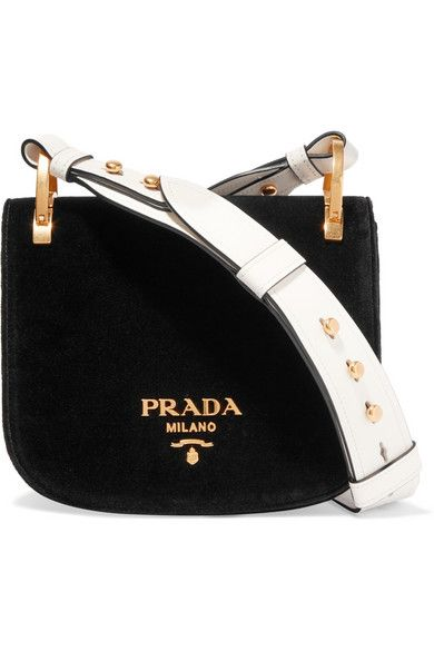 Prada's velvet 'Pionnière' bag made its debut on the critically acclaimed Fall '16 runway in Milan. The saddle-style shape is inspired by hunters' game bags and it's finished with a contrasting white leather strap and polished gold hardware depicting the original 1913 logo. An internal pouch pocket leaves the rest of the space free for your cell phone, makeup compact and cardholder. #Prada