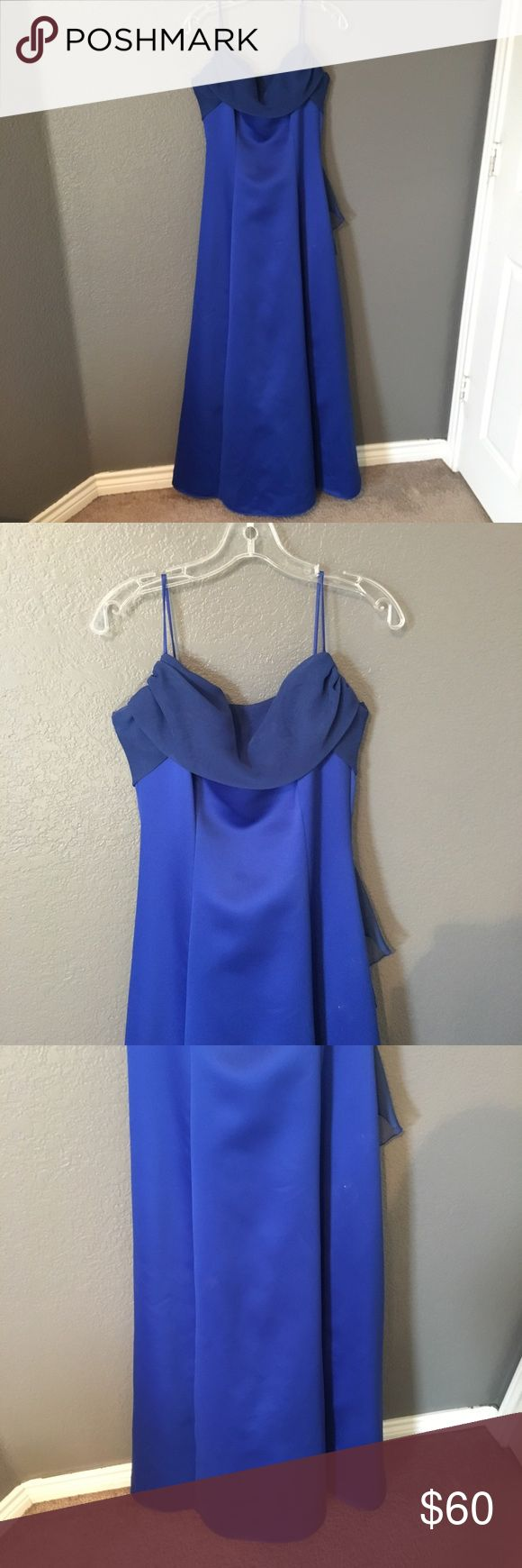Blue Prom Dress Beautiful dress to make you look absolutely stunning on prom night or at any other formal occasion. Has spaghetti straps, netting underneath, zips in the back, and a beautiful bow. Size 11/12. Lining inside is purple. Fabric distribution pictured above. Only worn once and in excellent condition. No trades, no holds, serious inquiries only. Dresses Prom