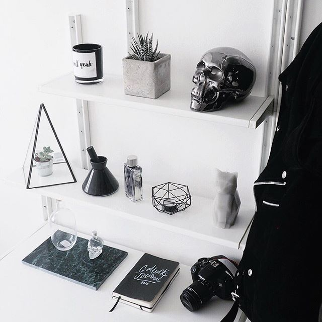 Shelves on either side of desk. crystals statues. Love this idea