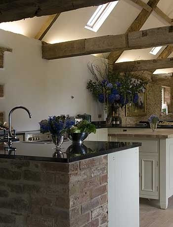 Kitchen with Natural Materials and Vaulted Celings