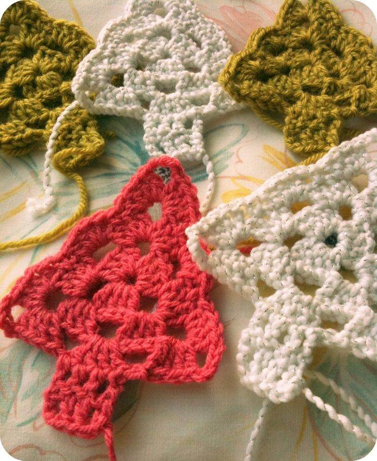 crocheted trees for a garland? I might make some of these as singles for ornaments!