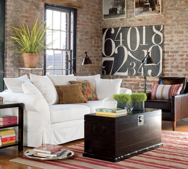 brick walls, large artwork, darks mixed with lights! This room makes the cut. :)