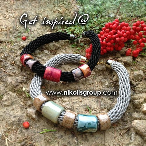 Necklaces made with enamel ceramics with hole 15mm. Find them @ www.nikolisgroup.com