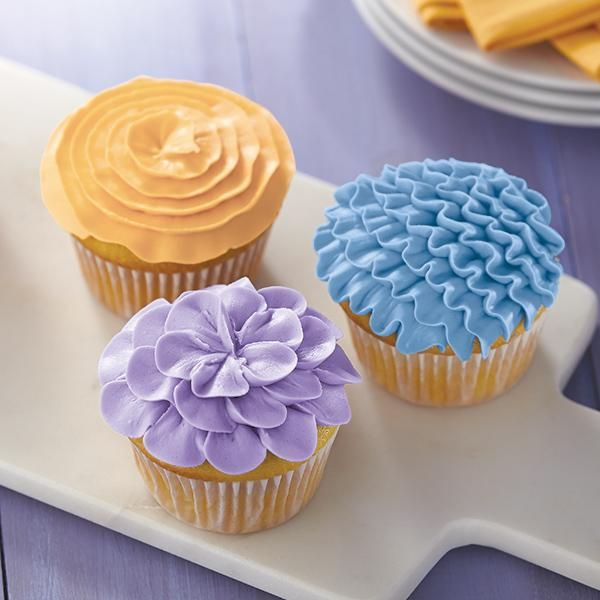 Party cupcakes are always a welcome treat. When you tint the icing in soft pastels like these, your cupcakes are going to be the talk of the event. Tint icing with Wilton's Color Right™ Performance Color System.