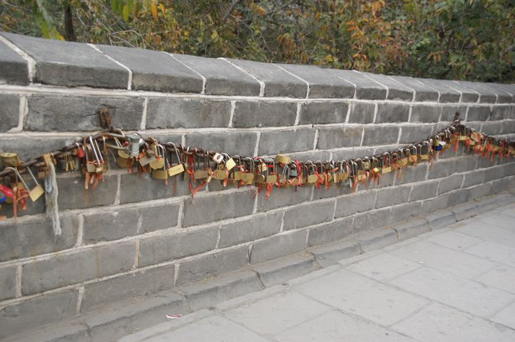 The Padlock Wall at the Great Wall of China, Beijing. Two hearts locked forever. October 2011