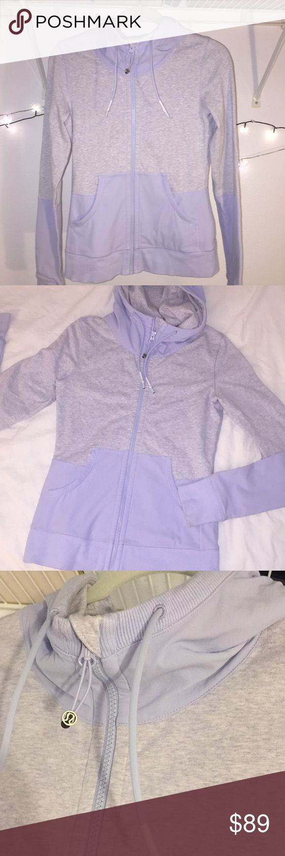 Lululemon hoodie Perfect condition lululemon hoodie. Material is thick and amazing quality. This is meant for a tighter and slimming fit. It's amazing! Selling bc I grew and my shoulders are too broad. Amazing light purple/periwinkle and heathered gray. True to size. Fits a 4/6! lululemon athletica Tops Sweatshirts & Hoodies