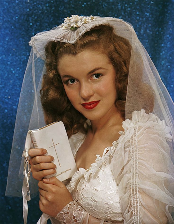 A rather holy Marilyn Monroe on the occasion of her marriage to James Dougherty at age 16, photographed by Richard Miller (June 19, 1942, colorized)