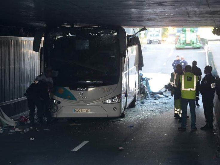 Coach crashed into low bridge