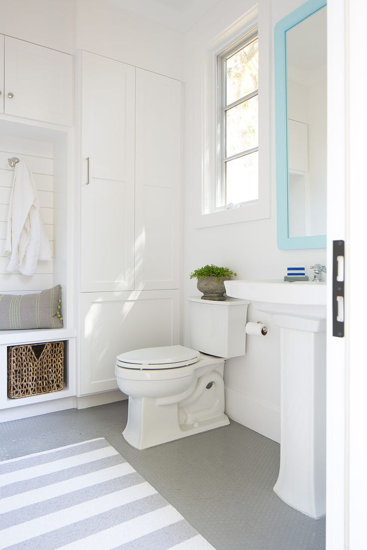 Modern blue and white bathroom - Pretty Beachy White Bathroom Design With Turquoise Mirror Modern Coastal Interior Decor