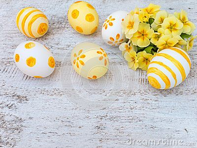 Decorated easter eggs and primrose flowers bouquet composition