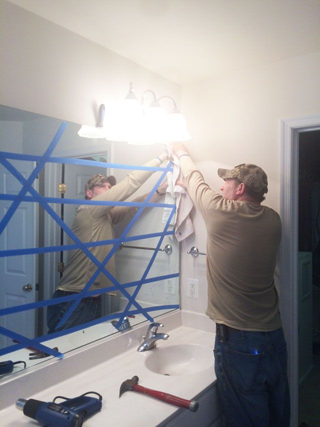 How to safely and easily remove a large bathroom builder mirror from the wall