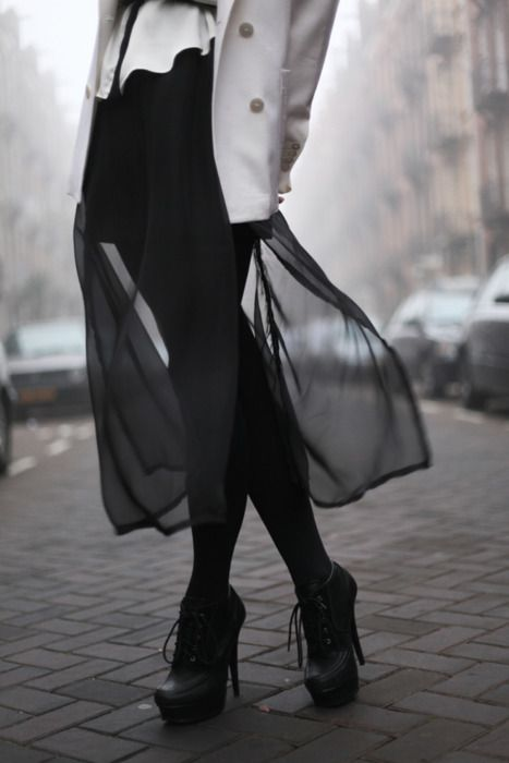 Love that diaphanous skirt topped with a proper jacket