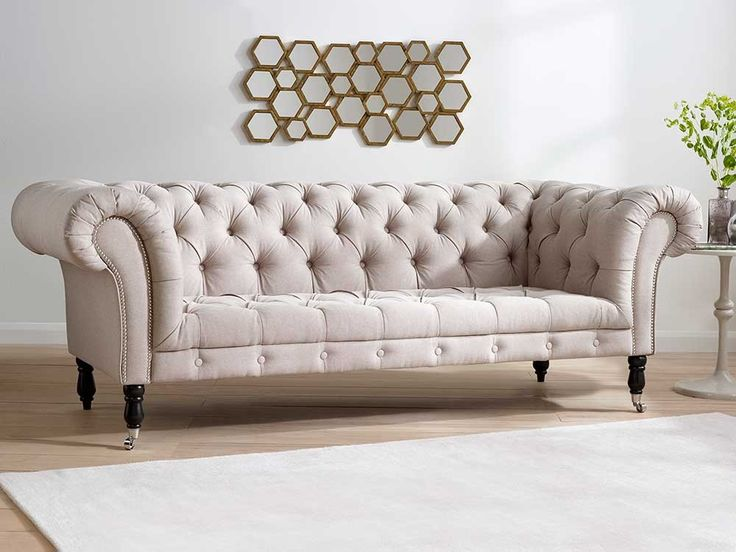 Sofa Sleeper Samuel Upholstered Sofa With deep padded seats buttoned upholstery and hand carved wooden