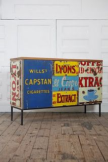 Vintage metal signs repurposed as siding on a sideboard