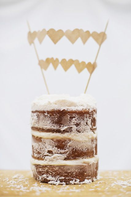 Coconut & White Chocolate layer cake with paper bunting.  alitamarie.blogspot.com.au