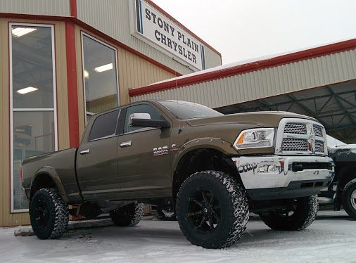 "Check out the latest BEAST we're building at Stony Plain Chrysler! 2014 Dodge RAM 3500 Laramie with a ProComp 6"" lift, 37"" tires rollin' on 20"" rims! And we're not done yet..."