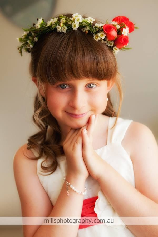 Braided sides help to keep hair out of the face and help to complement the flower crown.