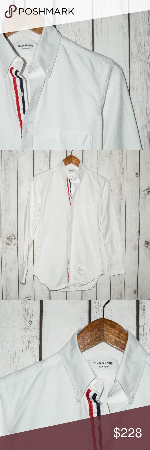 "THOM BROWNE  White Button Down Oxford Shirt THOM BROWNE Men's White Button Down Oxford Shirt Blue Red Stripe Size 0 USA Made  Size:  0  (Please SEE measurements)  Shoulder to Shoulder:16""  Chest (armpit to armpit): 18""  Length :27""  Sleeves:22.5""  Condition: Great overall Condition.  Color(s):White  Item #17110835 Thom Browne Shirts Casual Button Down Shirts"