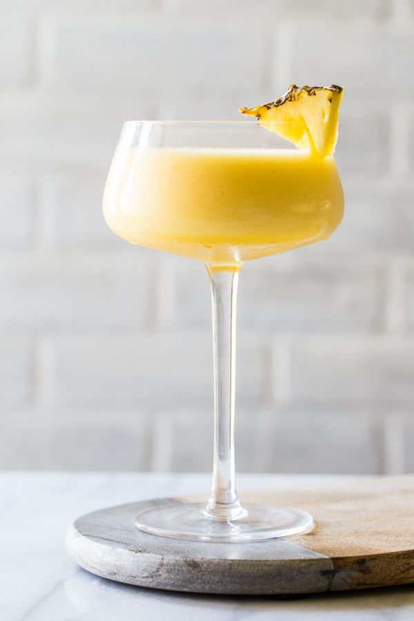 Frozen Pineapple Mango Daiquiris are so perfect for summer. Cool, smooth, and totally delicious!