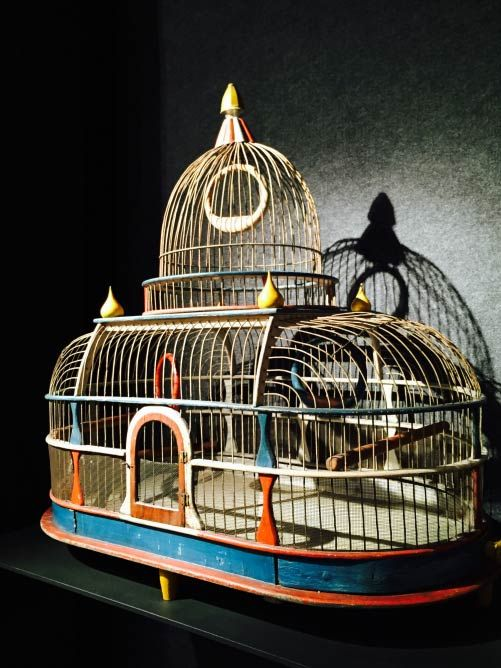 A Very Patriotic Birdcage (c. 1876) Modeled after the United States Capitol building, this colorful birdcage was likely crafted in celebration of America's Centennial in 1876. Still sporting its original red, white and blue paint