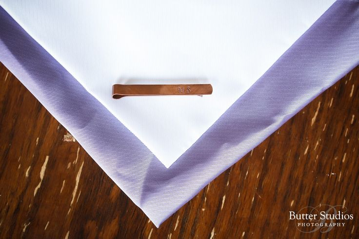 Grooms purple and white pocket squares with his cuff link!